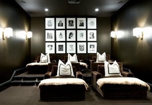 Screening that Screams Chic! I am dying over this in home theater. I just want to snuggle up in this space, cover up with one of the throws and watch one of my favorite movies. Love to homage to the silver screen icons on the back wall!