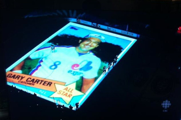 Very cool tribute to Gary Carter by the Montreal Canadiens, who beamed his 1985 Topps All-Star baseball card on the ice.  (via Darren Rovell)