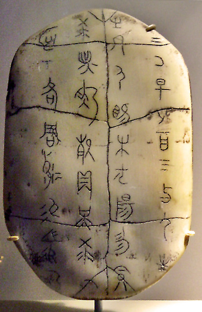 Oracle turtle shell  This is a replica of an oracle turtle shell with ancient Chinese oracle scriptsinscribed on it.Fu Xi, traditionally,considered the originator of theI Ching,is said to have discovered the arrangement of the eight trigrams in markings on the back of a mythicaldragon horse(sometimes said to be a turtle) that emerged from theLuo River. This discovery is said to have been the origin of calligraphy. [en.wikipedia.org/wiki/Fuxi]