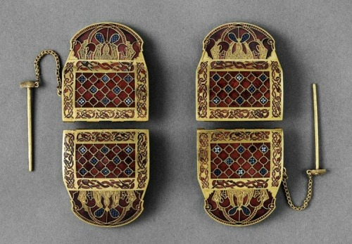 historiated:  Shoulder clasps with interlace, animal imagery, and geometric patterning from the Anglo-Saxon ship burial at Sutton Hoo (modern-day Suffolk, England), early 7th c. Image taken from ARTstor. Click through the photo for a larger image.