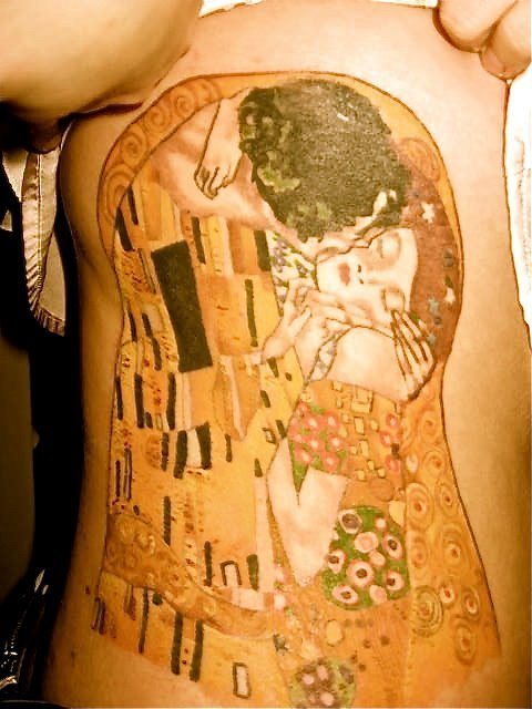 This is Gustav Klimt's kiss. I got this tattoo because it reminds me of my parents and a huge print has been hanging in my house for years. This is on my ribs and took about 3 sessions to complete. It was done by Carla Hopkins at Portside Parlor in Philadelphia.