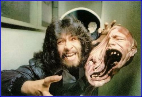 "celluloidshadows:  Special effects artist Rob Bottin with his monster creation for John Carpenter's 1982 version of ""The Thing"" starring Kurt Russell. Click the pic to watch a scene from the movie."