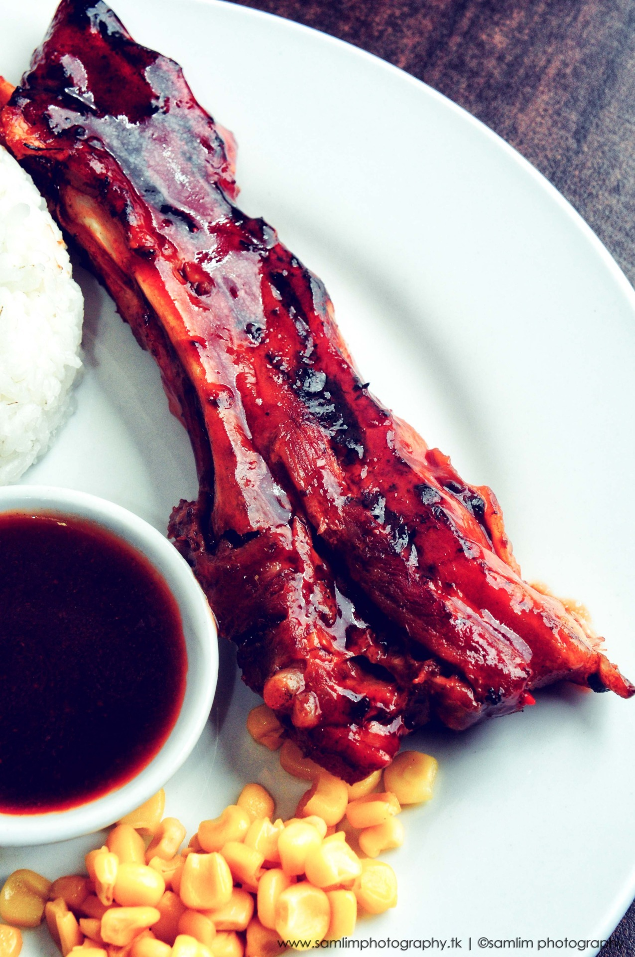 "Photographed by: Sam Lim Named as the World's Worst Ribs, a specialty from Lyndons, a well known ""hole in the wall"" restaurant in Davao, Philippines owned by Lyndon and Ruby Dabon.  This was one of the best Ribs I ever tasted in my entire life (maybe I'm exaggerating a bit, but you know what I mean)!  I know it's kinda weird that they named it as the World's Worst Ribs,.. but I gotta admit, it surely made me curious why they named it as so, thus, I got more excited to see and try it for myself and surprisingly, it did not disappoint!"