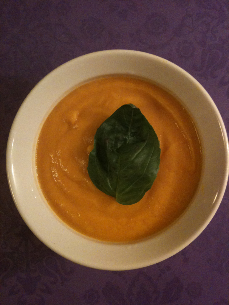 Carrot Ginger Spiced Soup My mom has been touting this soup recipe for a while and I finally got her to read it to me over the phone. She often has to make soup for 20 or so people and this one is one of her favorites. It is yummy, easy and low cost to make. If you don't have some of the spices go to a store with bulk spices and buy just a tiny amount. It is SO much cheaper that way. Carrot Ginger Spiced Soup 2 lbs carrots, sliced 4 cups water 1 tbsp olive oil 1 ½ cups chopped onion 2 medium cloves garlic, minced 2 tbsps fresh ginger, grated 1 ½ tsp salt ¼ tsp cumin ¼ tsp cinnamon ¼ tsp allspice 4 tbsp fresh lemon juice In a large pot bring the carrots and water to a boil. Once they reach a boil, turn down the heat and let simmer for about 10 minutes or until the carrots are tender. In a large skillet heat the oil over med/high heat and add the onions. Cook for about 5 minutes. Turn down the heat to medium to keep the onions from browning. Add the ginger, garlic, spices and salt until the mixture is soft and fragrant about another 5-10 minutes. Add the onion mixture and lemon to the carrots and water. Stir to combine. Transfer the mixture to the food processor, blender or Vitamix until it is nicely pureed. I started with the immersion blender, but the carrots stayed too chunky so I transferred it to the Vitamix at it gave it a wonderful mousse like texture. Serve immediately.