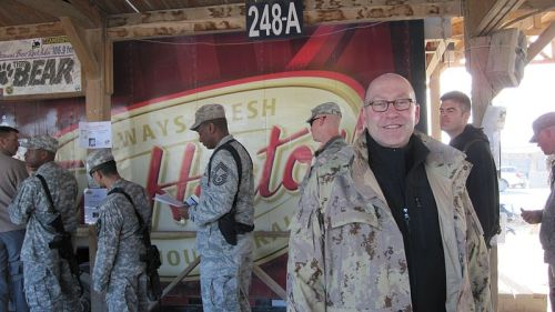 fuckyeahcanadianforces:  American and Canadian troops visiting Timmies at Kandahar Airfield on December 23, 2009. David Jacobson, United States ambassador to Canada, is pictured in the foreground.