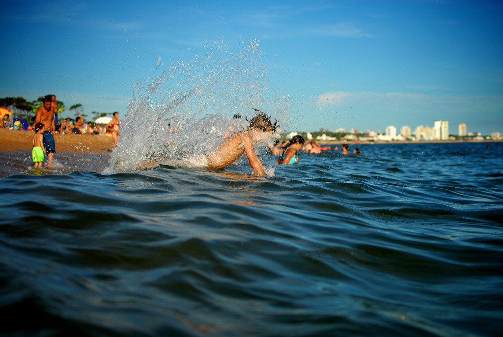 A boy having fun in the water at parada 34 of the Mansa beach in Punta del Este, Uruguay.