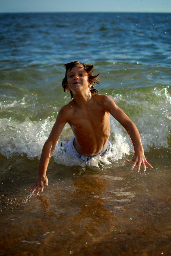 A boy playing in the water in Punta del Este, Uruguay.