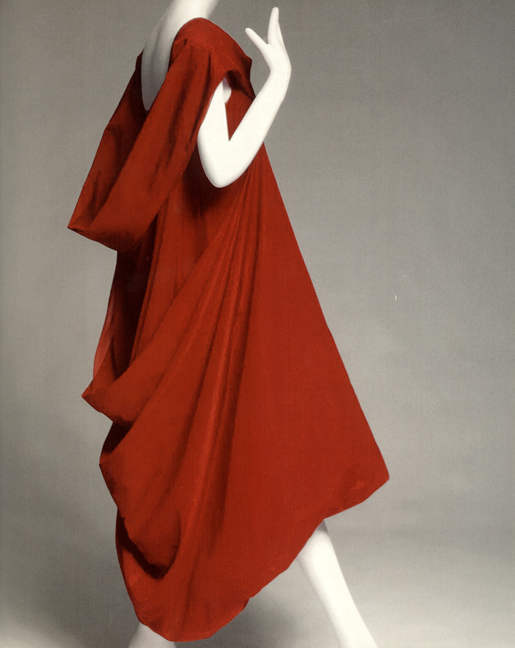 Rei Kawakubo for Comme des Garçons. red silk taffeta, Spring–Summer 1991Collection of the Museum at FIT Photography: Irving Solero  Formalism And Revolution: Rei Kawakubo and Yohji Yamamoto by Patricia Mears Japan Fashion NowPublished in association with The Museum at the Fashion Institute of Technology, New York