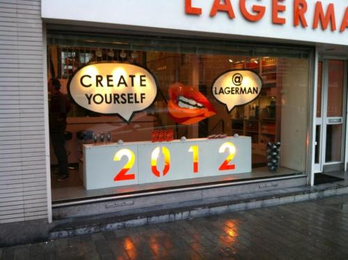 Shop window designed and dressed by KommaRiero for LAGERMAN Hairdressers. Dec 2011/Jan 2012 (by wintery daylight)
