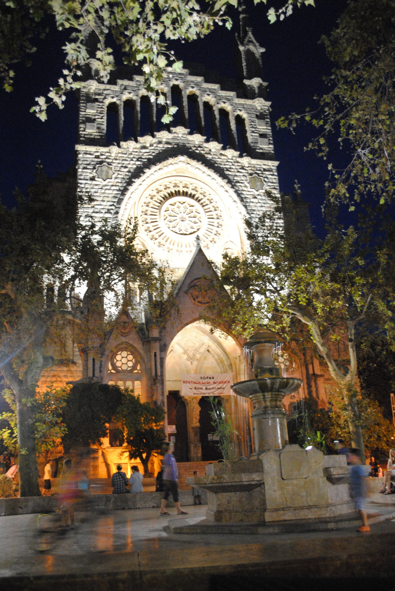 Location: Soller square, Mallorca Camera: Nikon D3000 While sat in the square at night I took this photo. The building is the Church of St. Bartholomew and was designed by one of Antonio Gaudi's disciples. I waited until dark in order for the Church to be lit up and highlight its beauty.