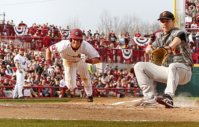 Chase Vergason dives to score South Carolina's first run during Opening Day against Virginia Military Institute on Friday. The Gamecocks, who won the national title last year, held off VMI, 2-1. (Gerry Melendez/The State/MCT/ZUMAPRESS.com)