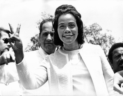 "Coretta Scott King flashing the peace sign at an anti-war rally at the White House on May 9, 1970. She was one of over 100,000 demonstrators who attended the rally to protest the war in Vietnam and Cambodia. Photo by Benjamin E. ""Gene"" Forte/Corbis."