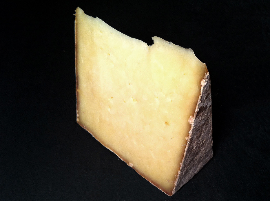 Landaff cheese, made by Landaff Creamery in New Hampshire, and affinaged at the Cellars at Jasper Hill. A Welsh farmstead (Caerphilly) style raw cows milk natural rinded tomme, with a firm, flaky, lightly eyed paste. With a lightly citric aroma, in flavor it is buttery, tangy, grassy, nutty and mild with just a little bit of sharpness and bite at the end. An absolutely magnificent melter and frequently spotted sandwiched between crackling bread at grilled cheese joints around town.  The San Francisco Chronicle has nice profile on Doug and Jenny Erb, the makers of Landaff, and how they came to produce this Caerphilly-style cheese. I love how the name of their hometown was the initial inspiration for their cheesemaking journey:  They knew that their town, Landaff, was named after a Welsh village, so Debby did some online digging to determine what cheeses might be typical in that part of the world. A fine one, as it happens. Caerphilly, now made primarily in England, originated in South Wales, in the vicinity of Llandaff (the Welsh spelling). The Erbs settled on Caerphilly as their model, and Doug went to England to work with Chris Duckett, the acknowledged master of artisan Caerphilly, and his disciple Jemima Cordle. Erb says that they shared all their procedures with him, and that the cheese he makes now - christened Landaff - follows their recipe. He can't get the same starter culture, but his methods are otherwise the same.  Rumor has it the Erbs are now working on a Tomme Crayeuse style cheese as well, stay tuned. Purchased at Beechers NY.