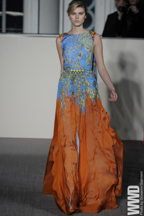"Matthew Williamson RTW Fall 2012 Full of bright colors, shimmer, prints, and sequins - this collection  didn't exactly scream ""fall-winter."" But that's Williamson for you;  always dreaming about the sun. So, with a hot-blooded customer base in  mind, Williamson turned out a collection packed with miniskirts and  dresses, some with jewels spilling down the front; others paved in  sequins arranged in digital mosaics."
