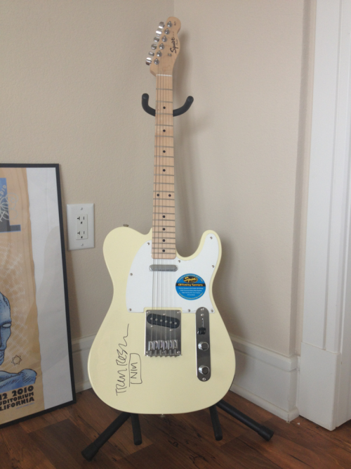Trent Reznor signed guitar, lovingly nicknamed Precious Whore, always gets a prominent position in my living space.