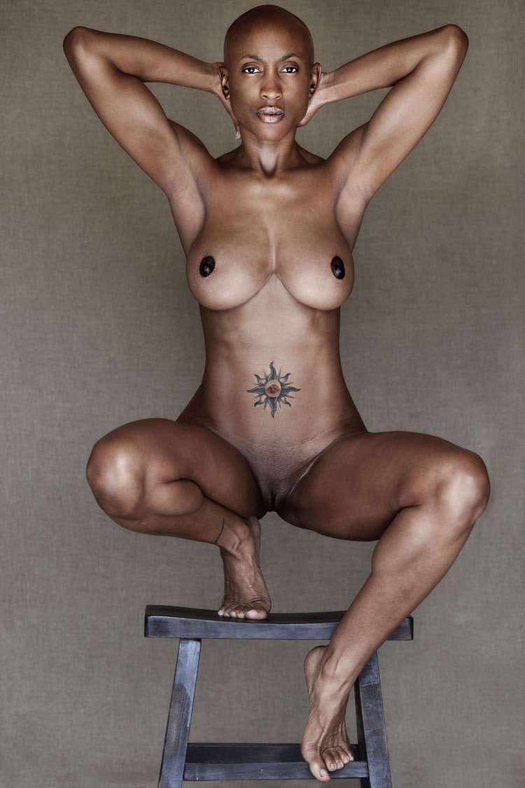 diversexity:  Strong pose, amazing physicality, gorgeous tattoo and a shaved head! So much awesomeness in one photo!