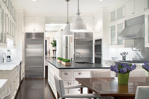 This is my future kitchen, I have always favored all white kitchens with carrera marble counters and a concrete island.  All it needs is a little more natural light!