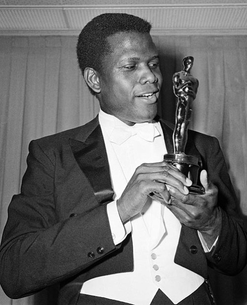 "bonaventurer:  The youngest of seven children, Poitier lifted himself from extreme poverty—his parents were tomato farmers who worked on Cat Island in the Bahamas, where they had no running water or electricity. At 15 and with no education, he went to live with his older brother in Miami, Florida, where he had an encounter with the Ku Klux Klan. A few months later, he arrived in New York with only $3, and then he answered an ad seeking actors for the American Negro Theatre. But when he flubbed his lines and spoke in a thick Caribbean accent, the director told him, ""Stop wasting your time—get a job as a dishwasher!"" The rejection galvanized Poitier. After months of mimicking American newscasters in order to lose his accent and of working in exchange for acting lessons, Poitier returned to the same theater company and landed a role in  Days of Our Youth . That began his ascent to becoming one of the most bankable actors of any race. In his 50 years in film, he has starred in and directed more than three dozen movies whose titles read like a time line for our memories:  The Defiant Ones , 1958;  A Raisin in the Sun , 1961;  Guess Who's Coming to Dinner and  To Sir, With Love , both in 1967. And when he won an Academy Award for his performance in the 1963 film  Lilies of the Field , Poitier changed film history: He became the first and only black person to receive an Oscar for best actor.  However remarkable his achievements, Poitier will tell you that he doesn't measure himself by these things—really. Especially during the Civil Rights movement when nonblacks often defined him solely in terms of race—and conversely, when some black people branded him an Uncle Tom who wasn't enough of a race revolutionary—Poitier's fight became not about race but about self—""In America,"" he tells me, ""it is difficult to be your own man."" But by focusing on the big picture—the breadth of who he is as a man, not confined by color—he has indeed embraced the fullness of his humanity. O Magazine 