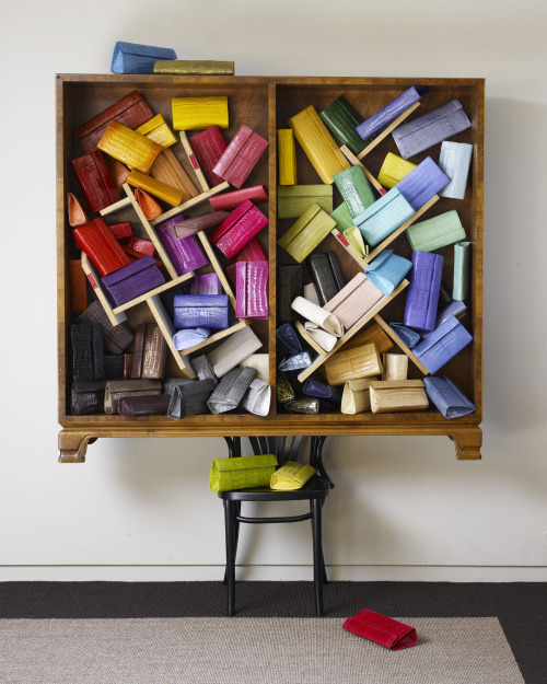 "A rainbow of Nancy Gonzalez crocodile clutches in Martino Gampers's ""Chair with Shelves"" in the Nancy Gonzalez showroom in New York.  We caught up with Santiago Gonzalez, son and CEO of Nancy Gonzalez, on his recent trip to Dallas.  Read about it on NMDaily."