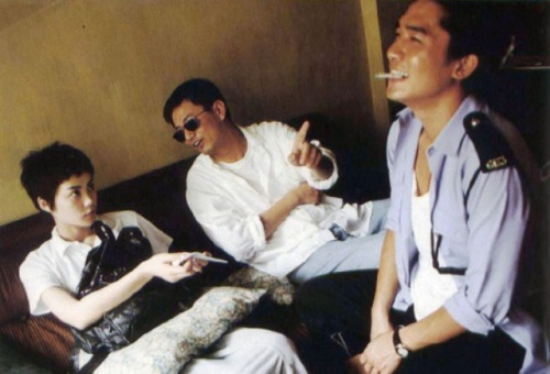 fuckyeahdirectors:  Wong Kar-wai with Tony Leung Chiu-wai and Faye Wong on the set of Chungking Express.