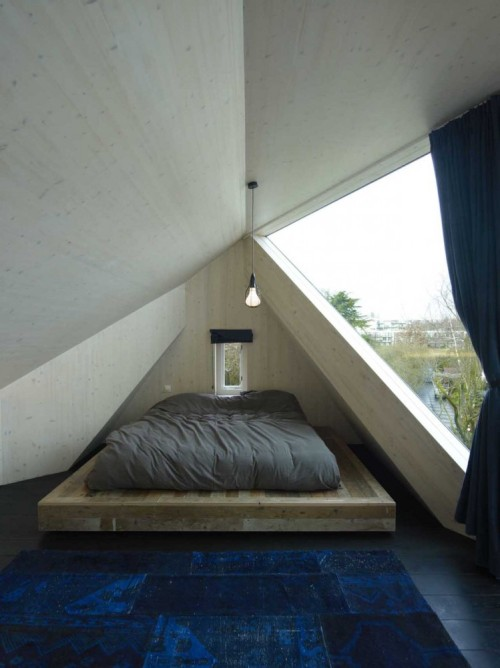 The angled ceiling, the little window, big window, platform bed, pendant, rug, view… can this be mine?