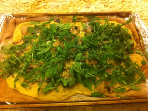 reblogged from sweetveganista:  Arugula and White Bean Whole Wheat Pizza! Easy peasy- mash up white beans, garlic and olive oil and spread on the whole wheat dough. Add mushrooms and onion. When it is all baked, top with arugula, garlic, and fresh chopped basil! Drizzle olive oil and sprinkle salt and pepper!  Healthy, so you can eat it all in one sitting. NO REGRETS!