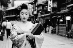 A geisha going to work at the Gion District, Kyoto.