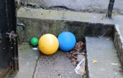Three Coloured Balls, One Green, One Yellow, One Blue, 2012 Photograph