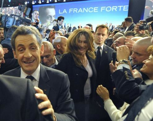 Bag's Take-Away:  To land a second term, Team Sarko will really have to shake it (…And if Carla can't, nobody can.)  via: Reuters Daily Edit  (photo: Philippe Wojazer/Reuters caption: France's President Nicolas Sarkozy (L) and First Lady Carla Bruni-Sarkozy (C) greet supporters at his first major re-election campaign rally in Marseille, southern France, February 19, 2012.)  Visit BagNewsNotes: Today's Media Images Analyzed  —————  Topping LIFE.com's 2011 Best Photo Blogs — follow us on Twitter and Facebook.
