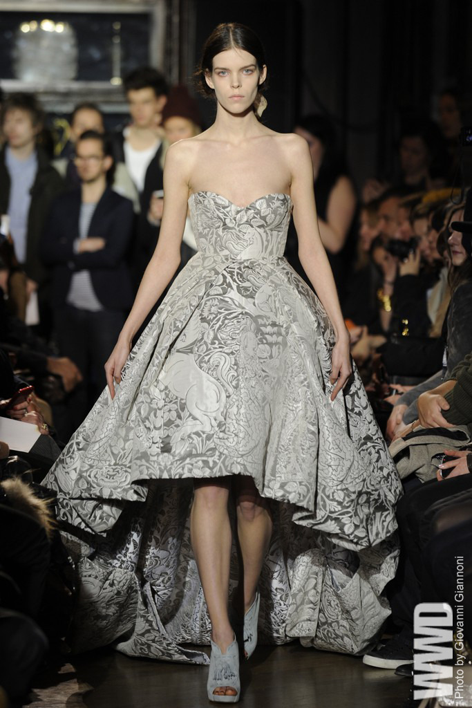 womensweardaily:  Giles RTW Fall 2012 Setting the house on fire. Giles Deacon brought new, fashionable meaning  to that expression, imagining a manor up in flames, and questioning:  What would its occupants might claim as their most treasure possessions?  Well, their evening finery, naturally. A scorched invitation summoned  guests to The Stationers' Hall, a storied livery company for the book  and publishing industry whose history stretches back to medieval times.