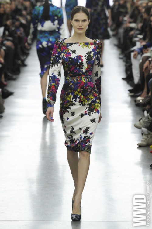 Erdem RTW Fall 2012 Erdem Moralioglu, known for his unabashedly feminine fashions,  challenged himself to create something darker and more potent this  season — and even a little kinky. With daring art patrons of yore in  mind — Peggy Guggenheim being one — the designer paraded his fall  collection in the White Cube gallery in Bermondsey, adding industrial  Latex to tweeds and other fabrics.