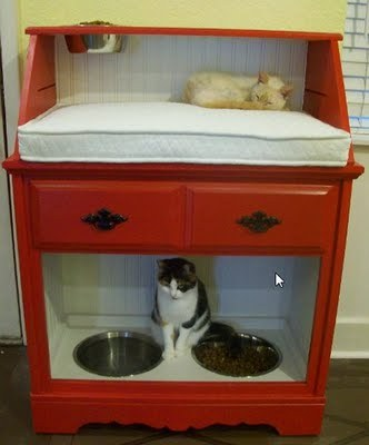 Genius pet station from Addicted To Decorating! Seriously. Trying to keep my dog out of my cat's food is a constant struggle. In our old place I would put it on the dryer in the laundry room, but I do not frequent the laundry room as much in the new place, so this would be perfect! Well this is and the floor space for it as well lol.