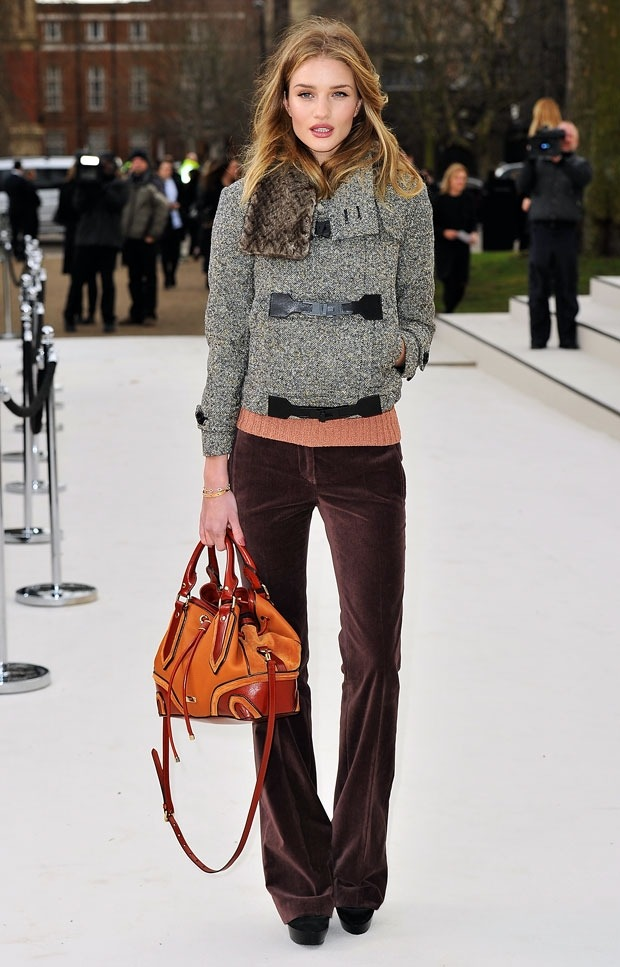 Rosie Huntington-Whiteley arriving at Burberry's fall 2012 runway show wearing a fantastic pair of flared pants.