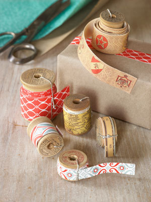 ohyaydesign:  Make your own tape out of wrapping paper. Click on source for tutorial!  My favorite part of this is the fact that you can use old sewing spools and a twist tie to hold ribbon! SCORE.