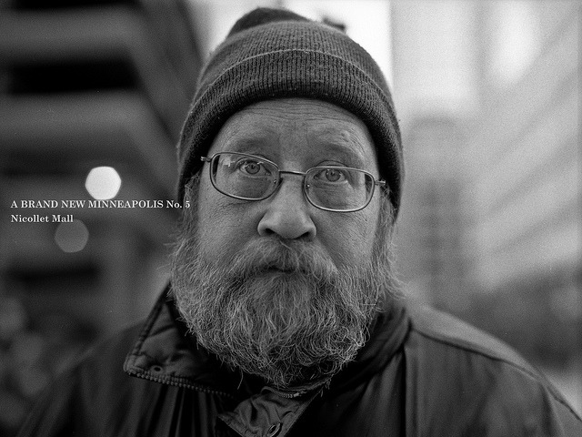 a brand new minneapolis no. 5 (nicollet mall) on Flickr.Mamiya 645 1000s | Mamiya Sekor-C 80mm f/1.9 (shot at f/2.8) |  Kodak Tri-x 400  (shot at 320) | Rodinal (1:100, 120 min.) This gentleman was waiting…for something at Nicollet Mall in downtown Minneapolis. He was a bit reluctant to have his photograph taken, but I guess my charms wore him down in the end! This picture is the fifth in my 100 strangers project, to learn more and see the rest of A Brand New Minneapolis, click here.  Find out more about the project and see pictures taken by other photographers at the 100 Strangers Flickr Group page