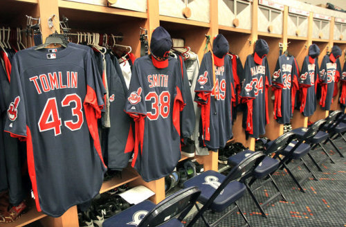 Chuck Crow/The Plain Dealer  A row of the spring training uniforms are ready for the players,  including Josh Tomlin's and Joe Smith's, at the Cleveland Indians spring  training complex.