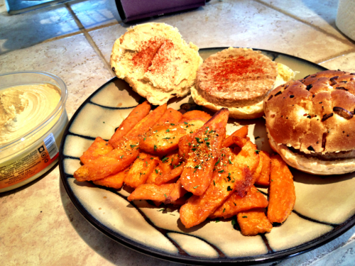 First meal at the new house! Veggie burgers topped with hummus and cayenne on toasted onion buns with a side of spiced sweet potato steak fries.