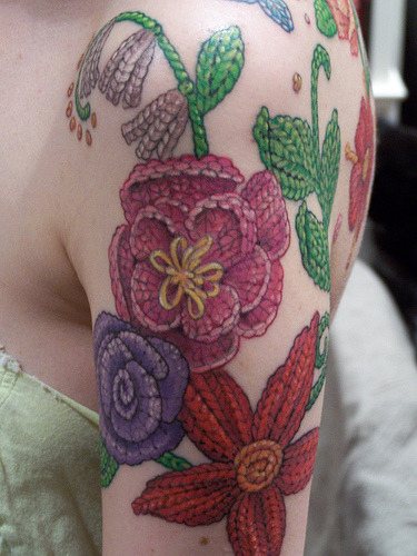 wellaubydamned:  peayeahknow:  [Image: Tattoo of colorful knit flowers on an arm and back. E.D.] roseylivesonaboat:  I think this might be the most beautiful tattoo I have ever seen. Another picture if you click through!  oh  omg i adore this!