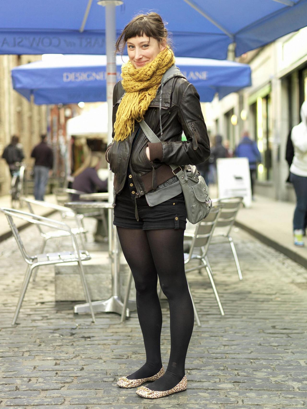 Black tights and shorts with leather jacket and leopard print flats