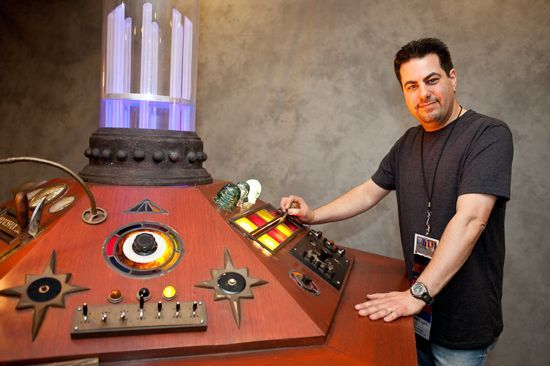 doctorwho:  Doctor Who Fans Refurbish TARDIS Console From 1996 Movie for Gallifrey One Convention  Paul J. Salamoff is a former special effects artist from Burbank who now works as a writer and producer. He's also the owner of the TARDIS console from the 1996 Doctor Whotelevision movie starring Paul McGann. This weekend, he unveiled the refurbished prop at Los Angeles' annual gathering of Whovians, Gallifrey One. It makes sense that Salamoff, who gave the prop a new life with the help of two other fans, would choose Gallifrey One for the big reveal. A Doctor Who aficionado since childhood, Salamoff has been attending the convention for at least 15 years. While this convention still flies a little under the media radar, Gallifrey One is becoming better known as more and more people in the U.S. are obsessing over the long-running British sci-fi franchise, which on BBC America. It was a long, arduous process that one of Salamoff's cohorts documented on his blog, but the response was worth it. The eighth Doctor himself, McGann, stopped by with his son to play with some of the controls.  Read the rest of the interview at LA Weekly. You should also check out their slideshow of photos from Gallifrey One  Awesome! You gotta love die-hard fans. In case you haven't seen it, Paul McGann and Daphne Ashbrook recorded a short message for us in front of this console.