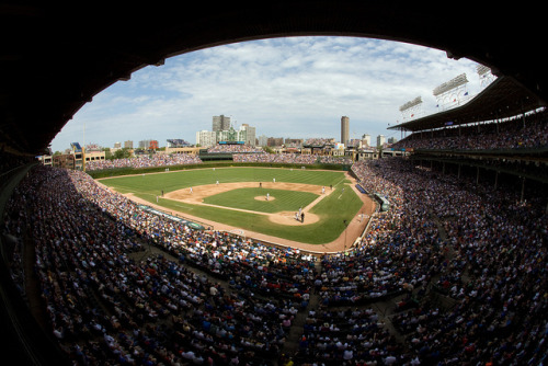 "Moneyball: Cubs team up with Sox in offering 'dynamic' ticket prices — After years of being out-hustled by secondary ticket brokers, which flip high-demand seats for huge profit, the North Siders are stealing a page from their South Side rival's playbook and implementing ""dynamic pricing"" in their 5,000 bleacher seats this season. Now, if demand spikes, the Cubs can hike prices much like airlines do as departure time nears. Credit: The real David Fullarton / Flickr"