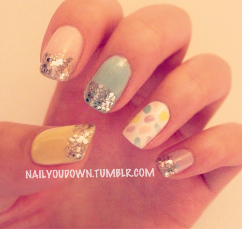 nailyoudown:  My take on sprinkles. It came out looking very Eastery. The glitter tips are Essie's 'Set in Stones.'