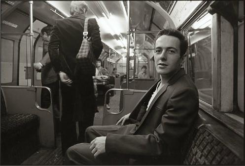 """In 1981 I happened to see Joe Strummer – he was the singer for the punk rock band The Clash – on the tube. I saw him sitting on the other side of the seat, but I thought he was too private – he might get too angry – but I was trying to be brave, I went up to him and asked him 'may I take a picture of you.' he smiled and said 'yes', and I clicked several shots.  Just before he got off the train he said to me, 'You should take photos of whatever you want. That's punk.' ""  Herbie Yamaguchi."
