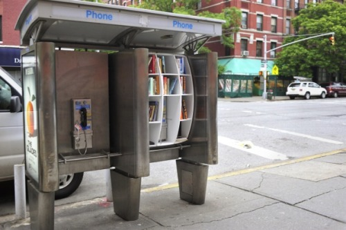 "vikingpenguinbooks:  How New York Pay Phones Became Guerrilla Libraries An interview with the creator The concept, sponsored by Locke's imaginary Department of Urban Betterment, is that New Yorkers will pick up unfamiliar titles while running their errands and then, perhaps, replace them the next day with favorite books of their own. That's in an ideal world. Of the twoguerrilla libraries that the artist has fashioned, one has been used properly while the other has had its entire collection repeatedly ganked by sticky-fingered pedestrians. Its shelves were also stolen. But Locke has many more libraries planned. With plywood consoles that slip over payphones as neatly as aprons, these sidewalk objets are endlessly replicable. (No doubt they'll feature in his 2012 Columbia course, ""Hacking the Urban Experience."") I caught up with Locke over the weekend to ask him about what was and wasn't working with these literary outposts, as well as why he started the project in the first place.  More at The Atlantic  This is an incredible idea. I'm going to try and find one pronto."