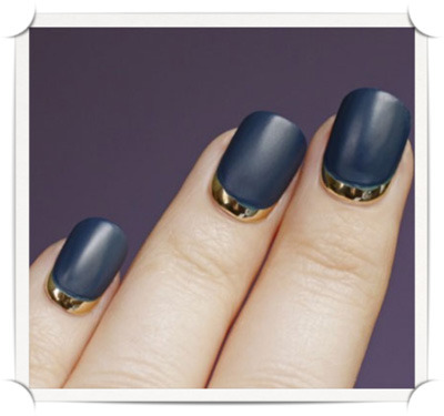 modcloth:  A gold and navy manicure via This is Glamorous.