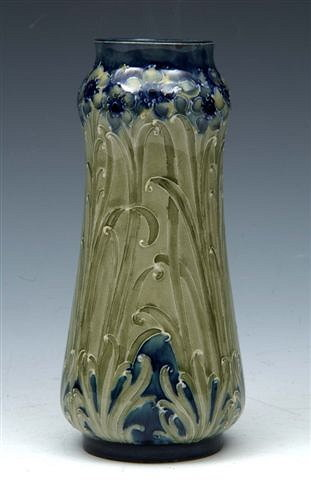 "A WILLIAM MOORCROFT FLORIAN VASE, with a version of the Violet design  (unknown until recently), made for Liberty & Co, signed to the base  and marked 'Made for Liberty & Co', in green, 6 3/4"" high"