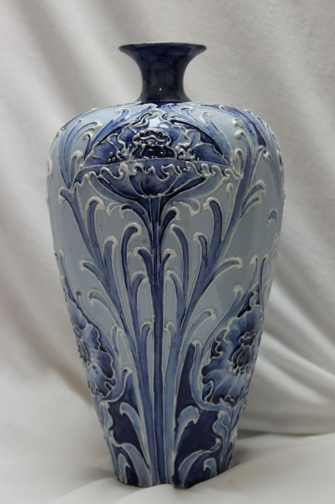 WILLIAM MOORCROFT  This early Moorcroft designed Florian Ware vase is decorated with the  Poppy design and carries the James McIntyre backstamp as well as William  Moorcroft's painted initials http://www.chinaroseantiques.com.au/products-page