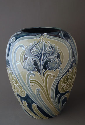"MOORCROFT vase  stands 8.75"" in HEIGHT and is well decorated in the FLORIAN IRIS pattern  designed and produced by WILLIAM MOORCROFT during his early period with  JAMES MacINTYRE & CO c1900."