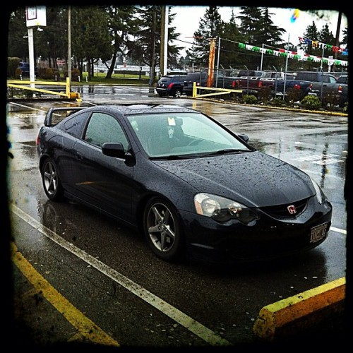 Type-S in the rain  #dc5 #rsx #honda #acura #jdm #slammed #coilover #type-r #k20 #oem+ #isntagram #iphone4  #photography #rain #parkinglot #grocery #tanabe #black #stance (Taken with Instagram at Langley Farm Market)