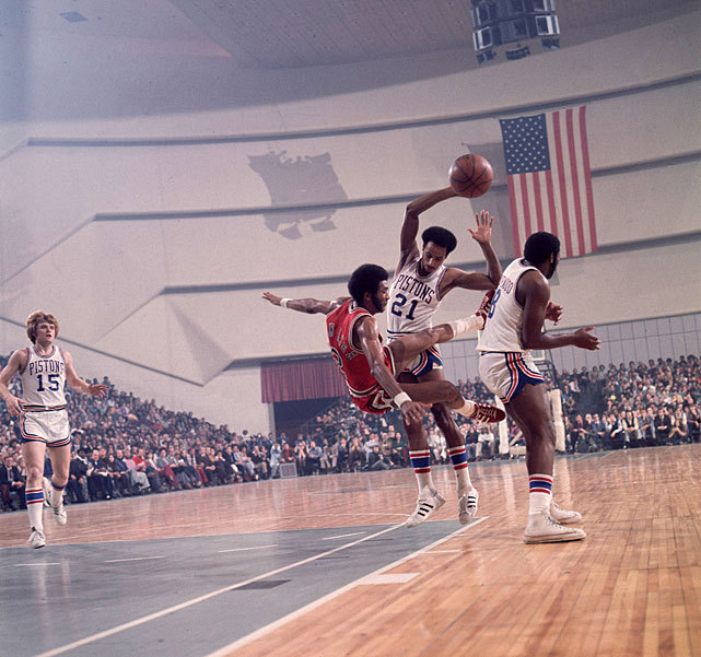 Norm Van Lier gets knocked off his feet by Dave Bing during a 1974 Pistons-Bulls game. (Lane Stewart/SI) SI VAULT: Bulls have improved, but can they knockout Milwaukee (1.21.74)